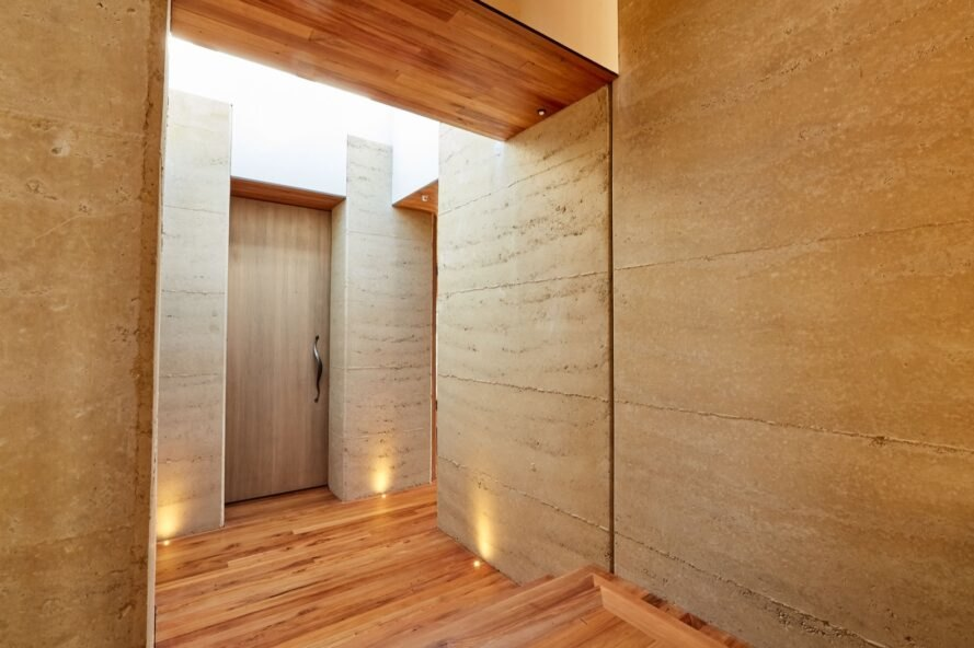hallway of rammed earth home