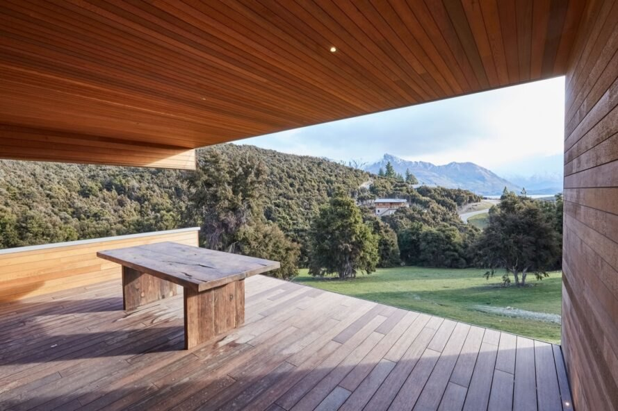 bench on an outdoor deck facing views of New Zealand