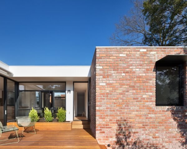 brick home with wood patio