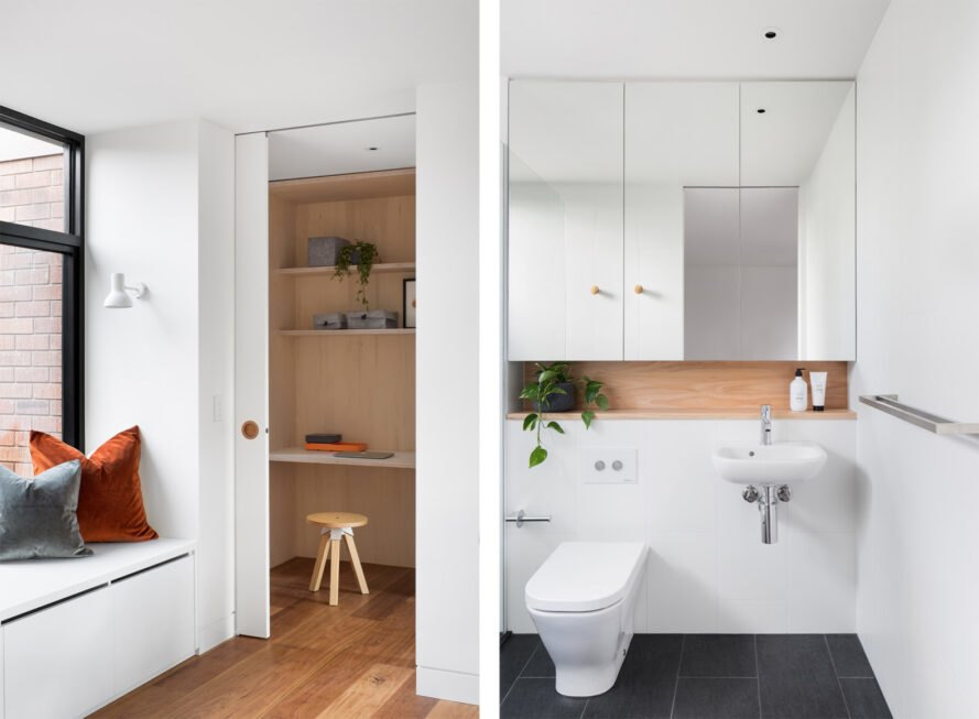 On the left, white bench near a window. On the right, modern toilet in white bathroom with dark tile floors.
