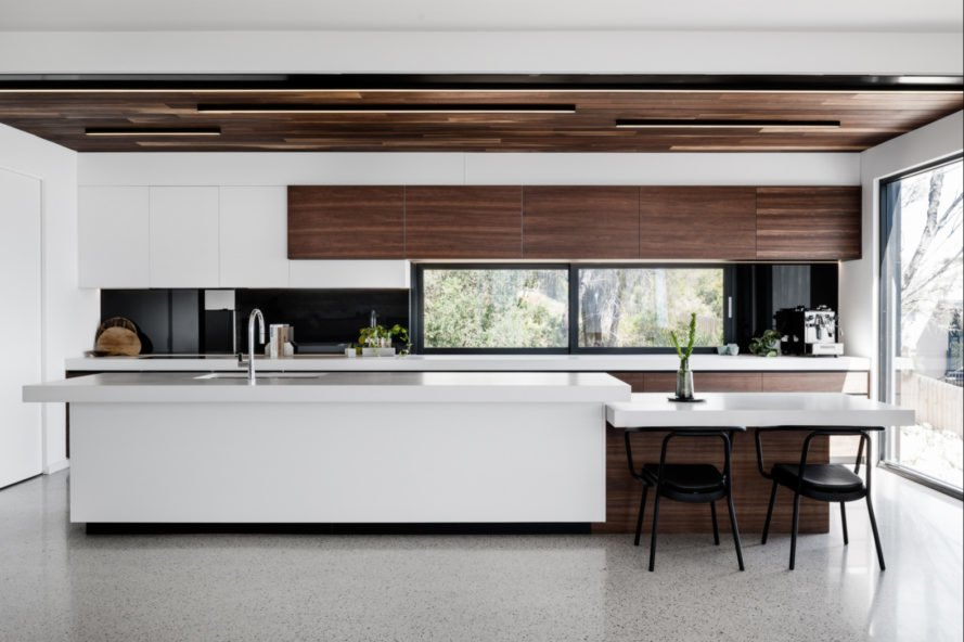 white kitchen with wooden planks