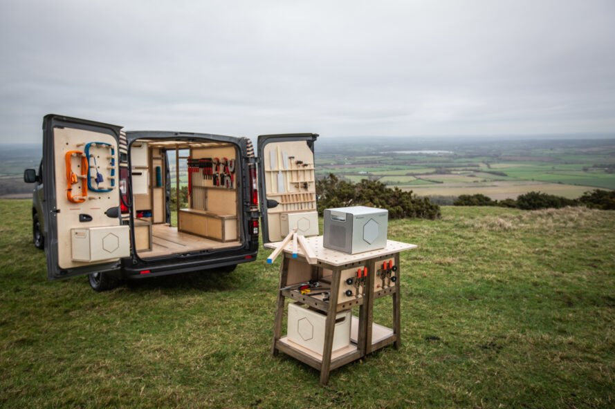 mobile woodworking shop with table out front