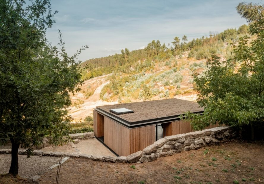 micro home clad in timber on a mountain