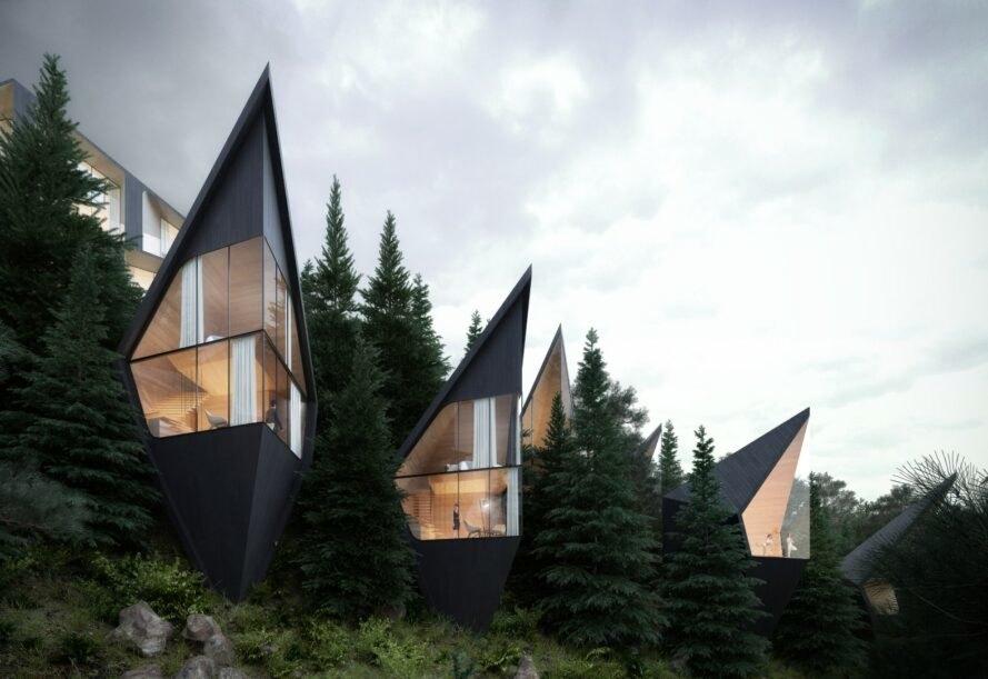 black triangular treehouses with huge glass walls