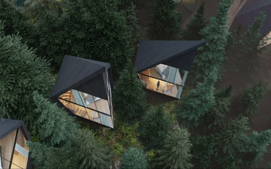 aerial view of triangular black treehouses