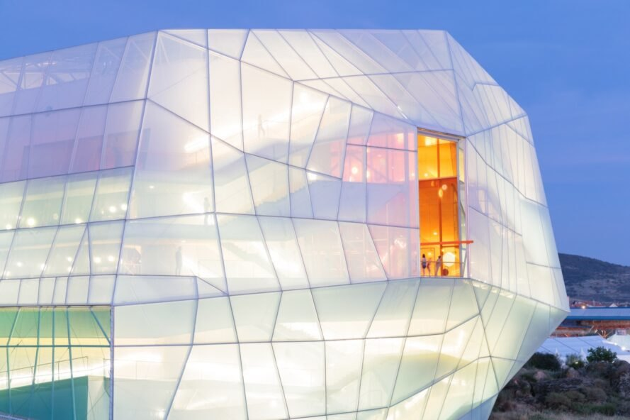 geometric building with clear exterior lit from within