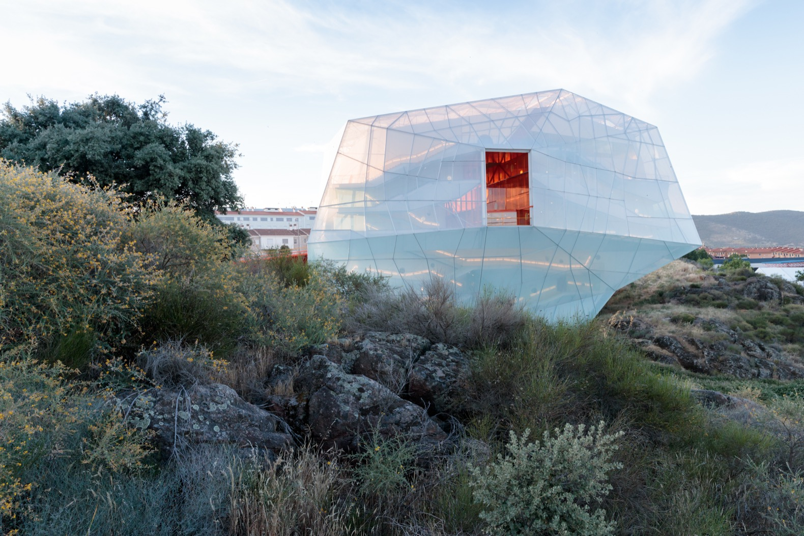 An auditorium uses translucent ETFE panels for a surreal look