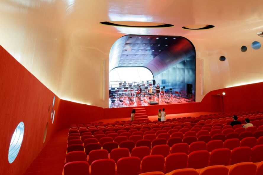 auditorium with red seats and floors