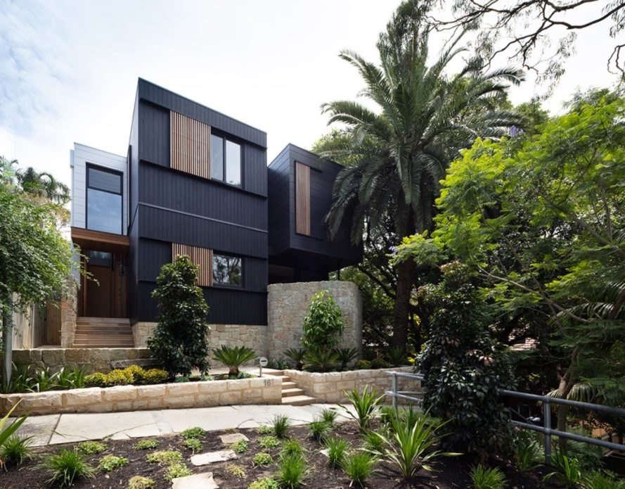 black two-story home with timber batten screens