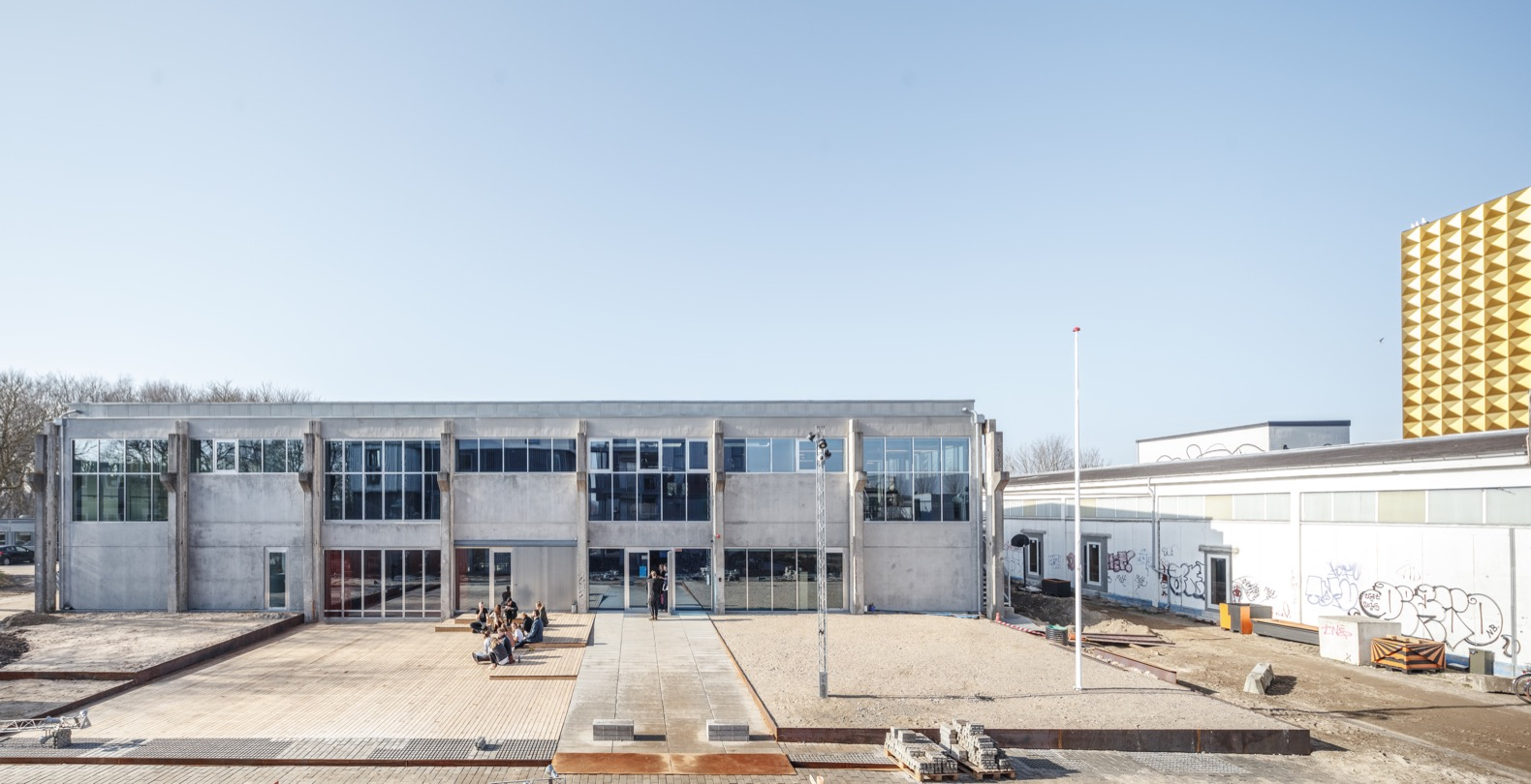 Former concrete factory is reborn as a unique music-inspired high school in Denmark