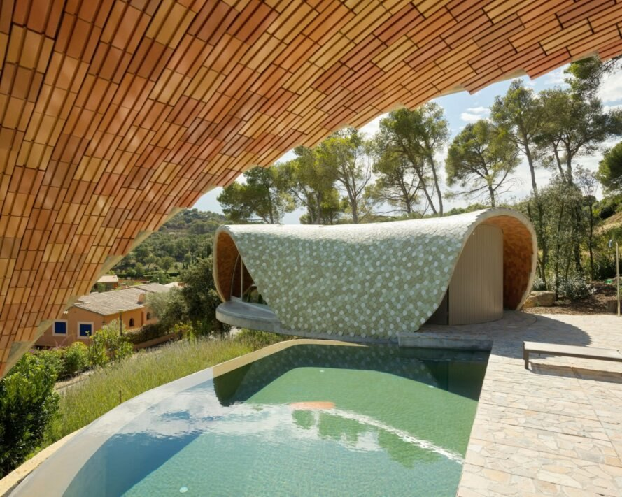 domed home with ceramic tile facade