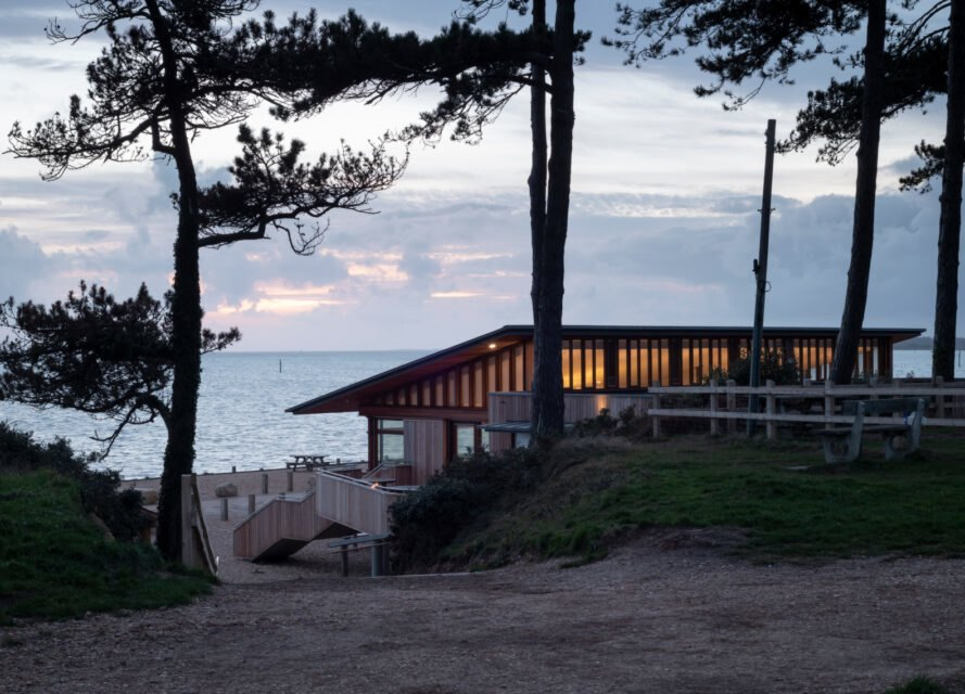 timber building on stilts facing the sea