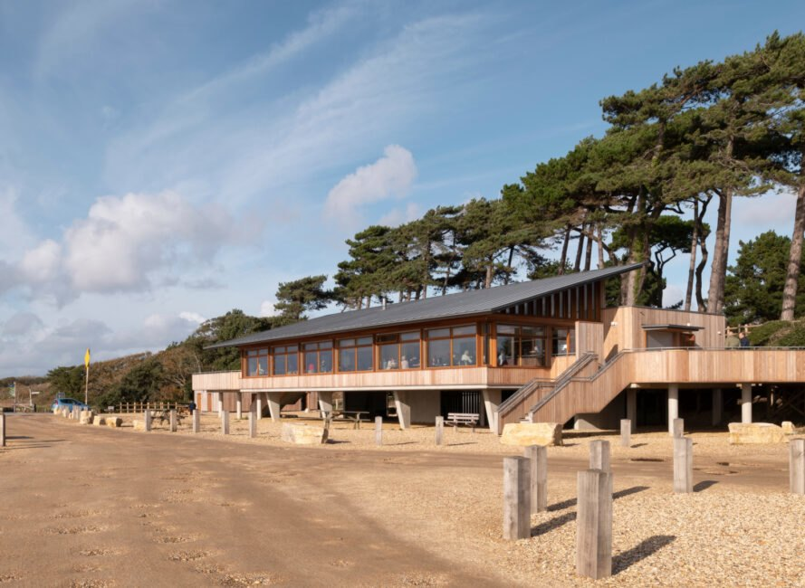timber building with a pitched roof on the beach