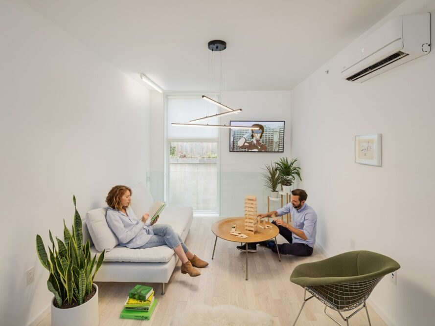 two people in an all-white living space