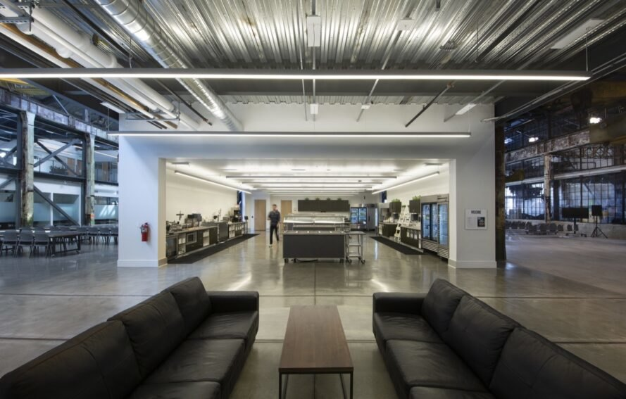 black couches inside a bright industrial building