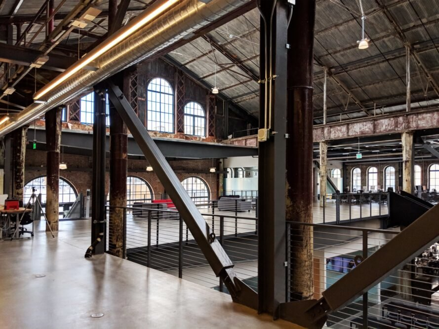 gray couches in huge industrial building
