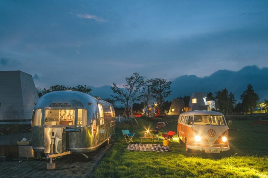 a renovated airstream on a glamping site