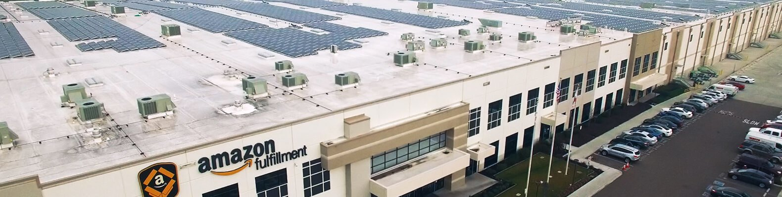 Amazon fulfillment warehouse building topped with solar panels