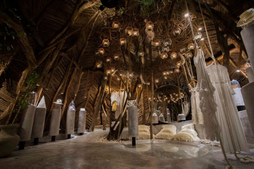 thatched room with hanging dresses