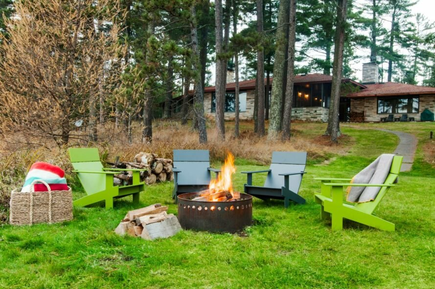 colorful patio chairs around a fire