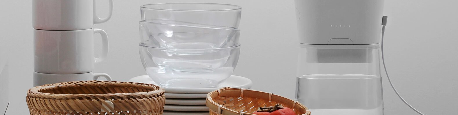 white carafe near stacked dishes