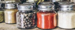 spices in glass jars on a shelf