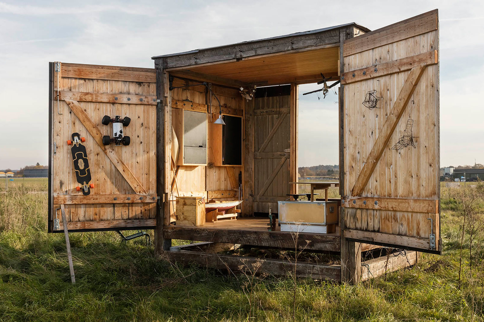 A tiny, 96-square-foot rustic pavilion brings the outdoors in
