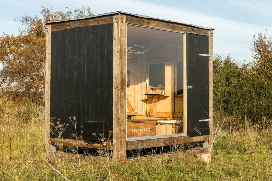 small wooden cube studio with glass wall