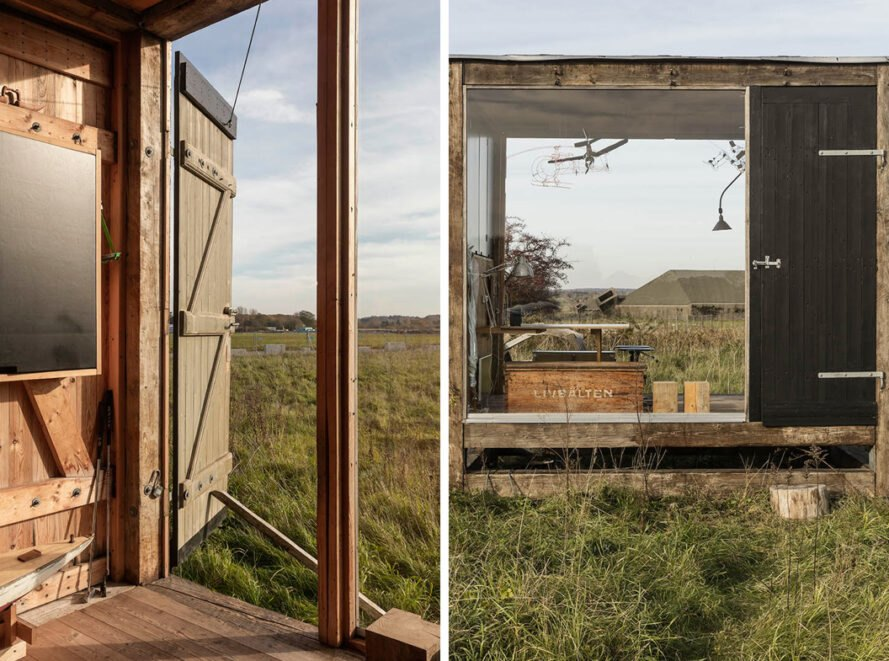 wooden cube with large glass walls that open to the outdoors