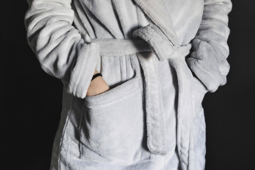 person wearing fuzzy gray robe