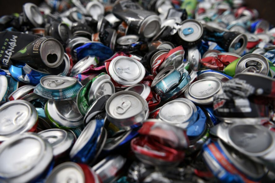 pile of compacted aluminum cans for recycling
