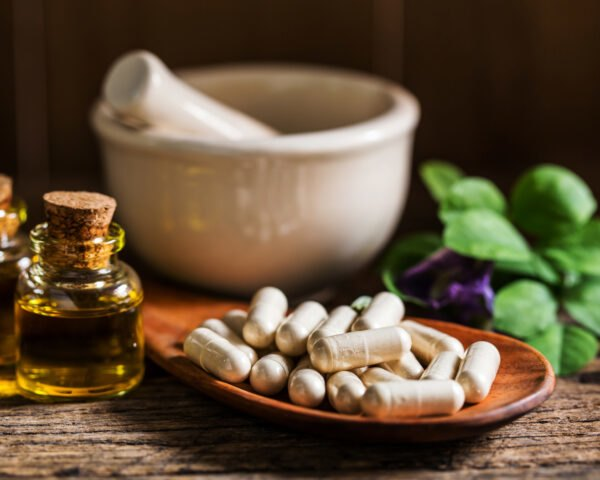 herbal pill capsules and natural oils