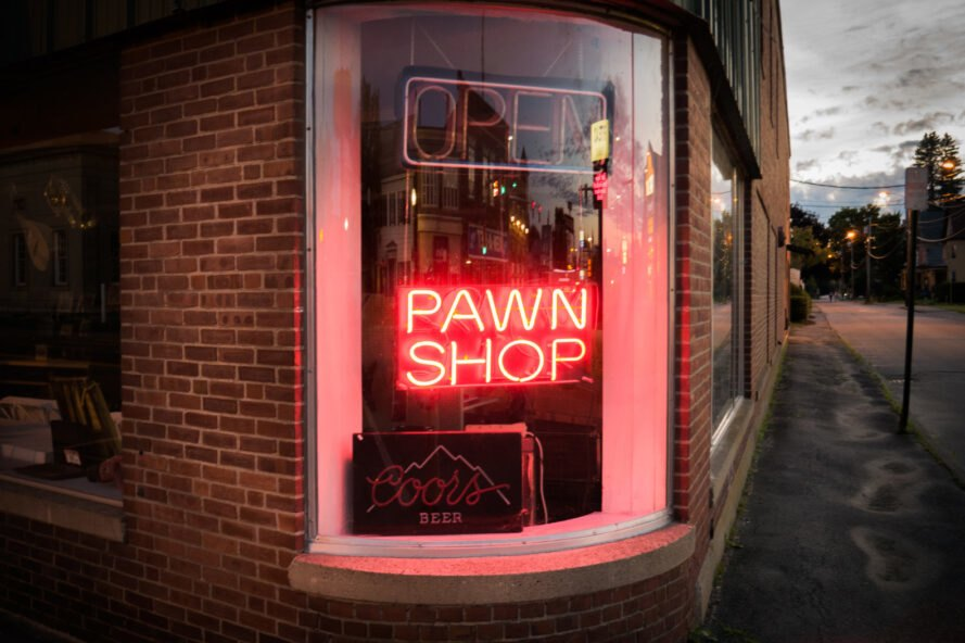 red neon pawn shop sign