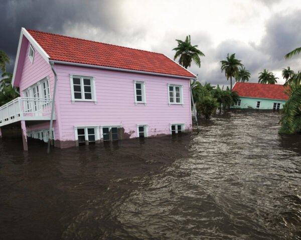 pink house in the Caribbean flooded during a hurricane