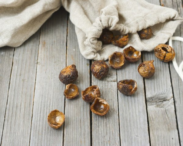 soapnuts spilling out of muslin bag