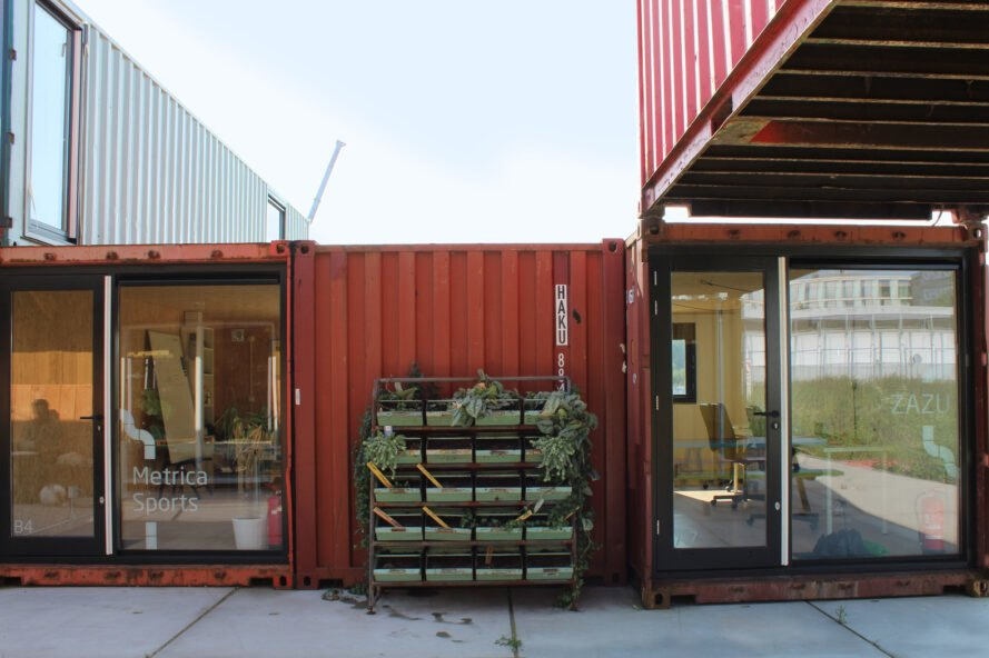 red stacked shipping containers turned into a home