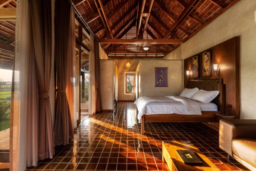 bedroom with stone tile floors and large wood bed