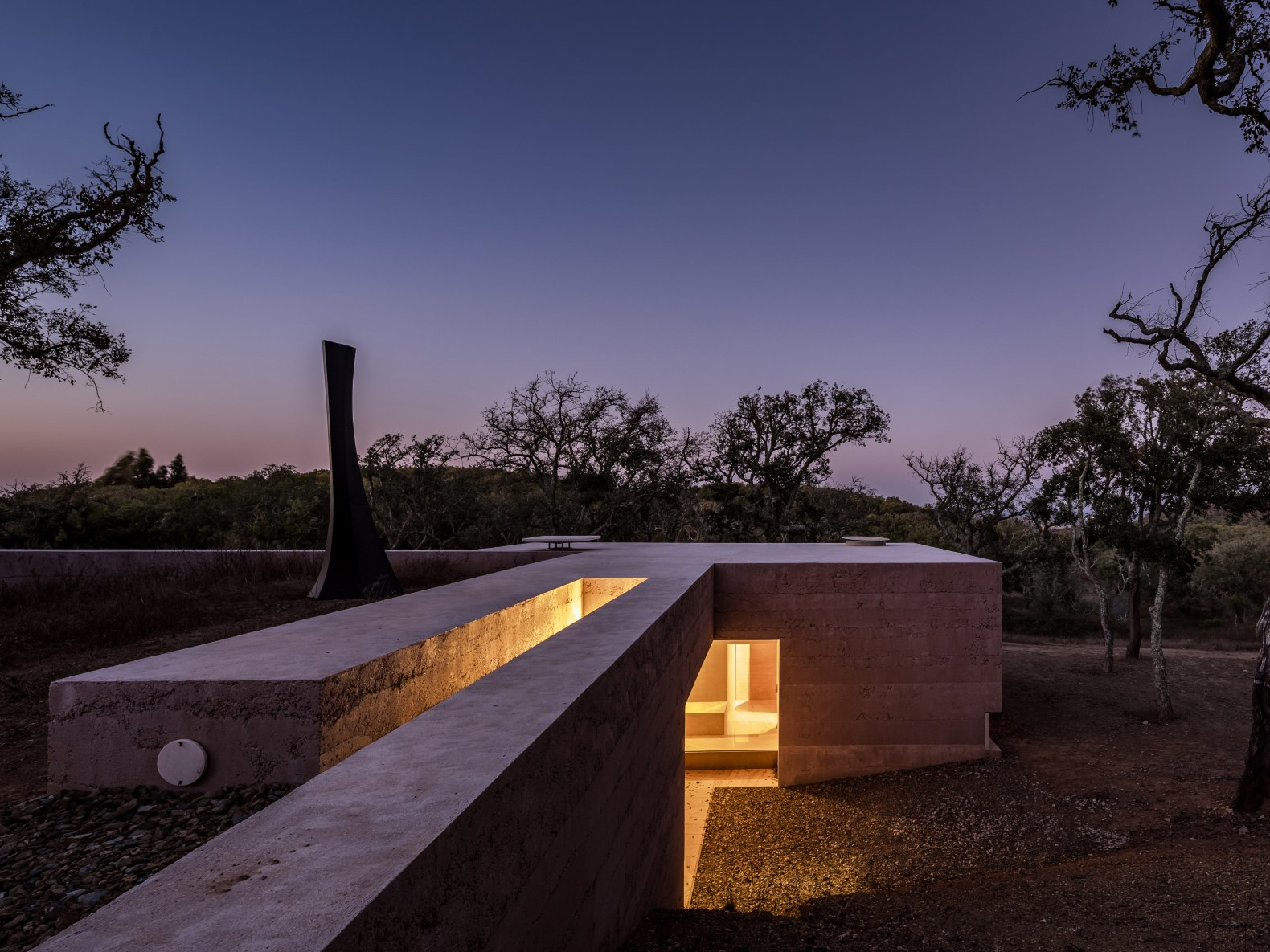 Rammed concrete home in Portugal boasts passive design features and a green roof