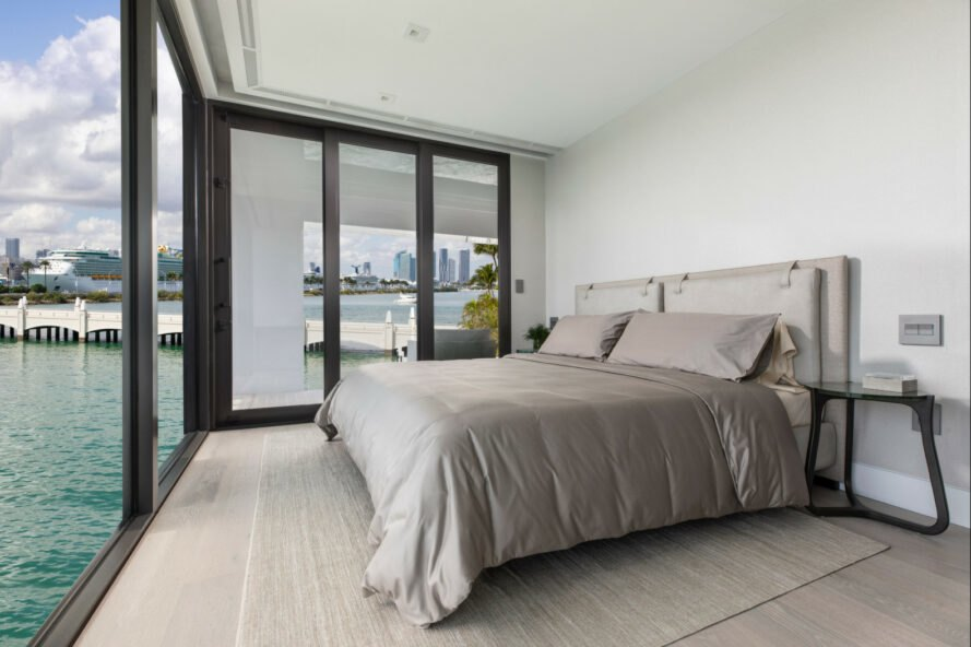 large bedroom with all glass facade