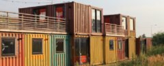 multi-colored shipping containers turned into home