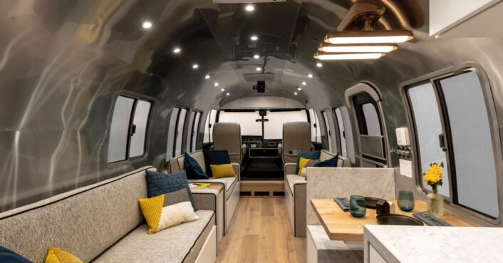 A 1989 Airstream is converted into a modern home on wheels for a family of 6