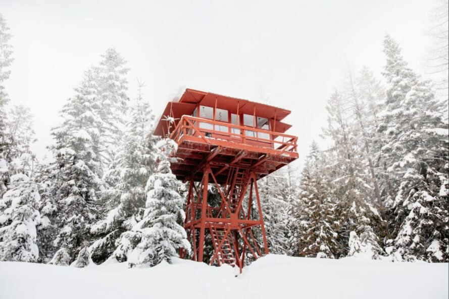 a red tower surrounded by a snowy landscape