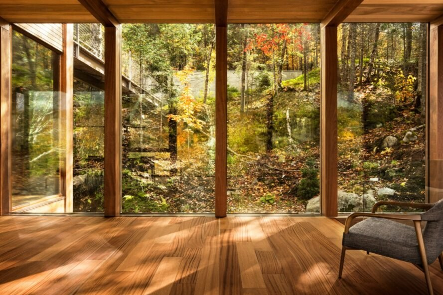 room with wood floors and glass walls