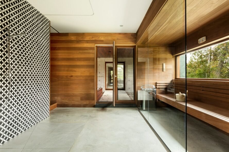 interior of home with concrete flooring and wooden walls