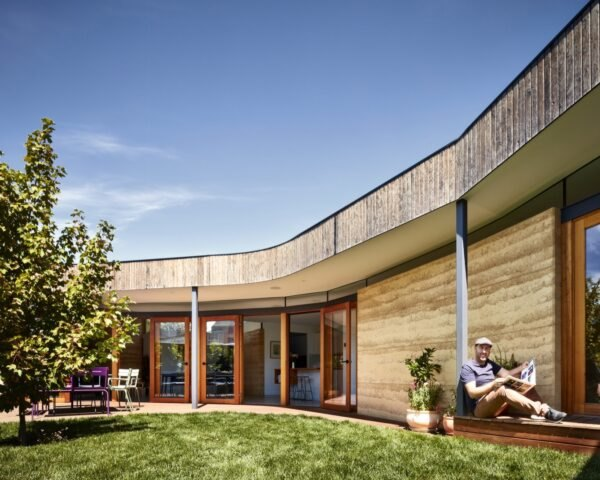 curved home with rammed earth walls