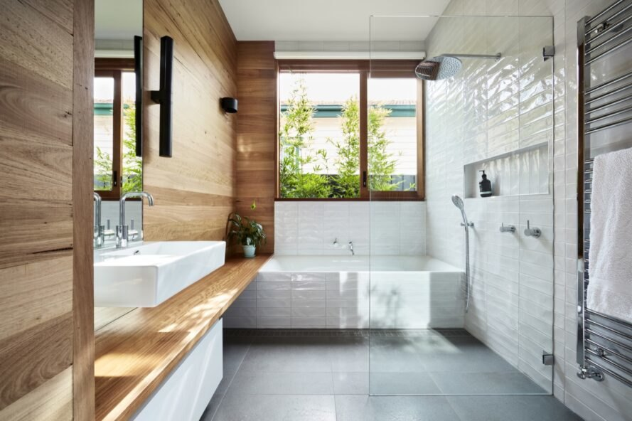 white bathroom with rammed earth walls