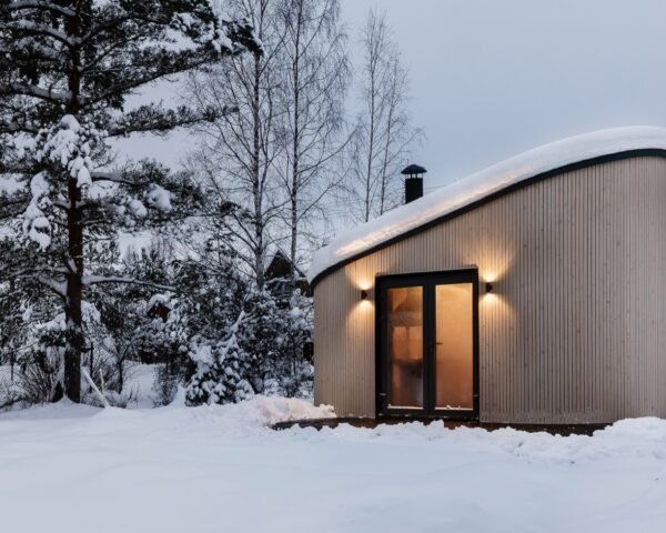tiny house surrounded by snow