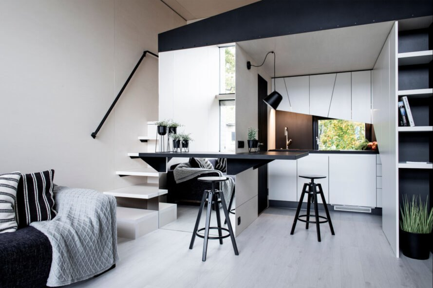 modern living space with white walls and black furnishings