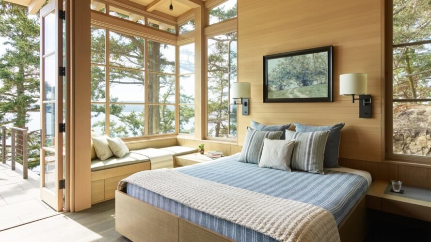 bedroom with large windows letting in natural light and clad in wood