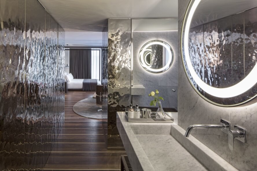 bathroom with metallic walls